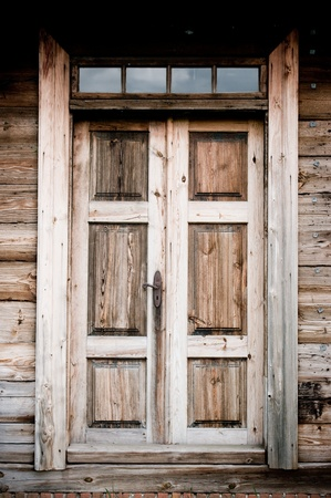 Old door in wooden cottage photo
