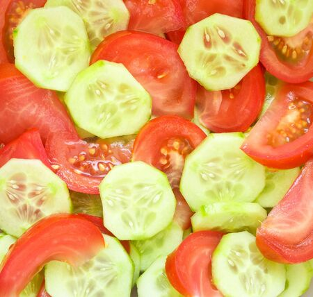 Cucumber and tomato for salad photo
