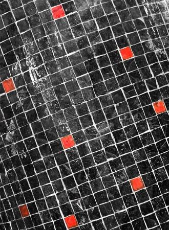 Black mosaic with few red blocks photo