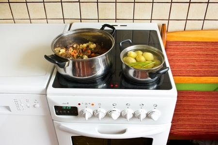 electric stove: Electrical cooker during the dinner preparation