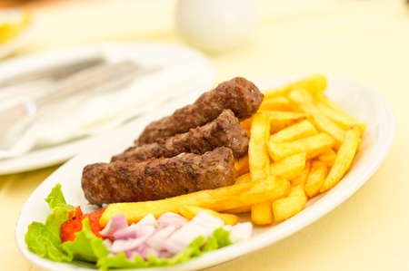 balkan: Cevapcici with chips Stock Photo