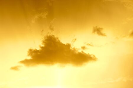 Separate cloud during the golden sunset photo