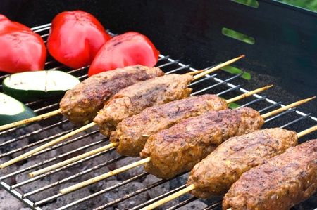 turkish kebab: Kebabs on the grill Stock Photo