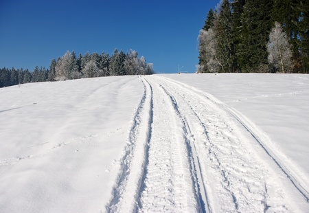 ski traces: Snowmobile track on the slope