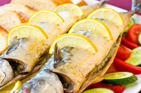 Baked mackerel with vegetables and lemon photo