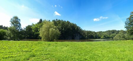 Green panorama near the lake photo