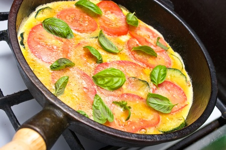 omelet: Omelette with tomato, courgette and basil