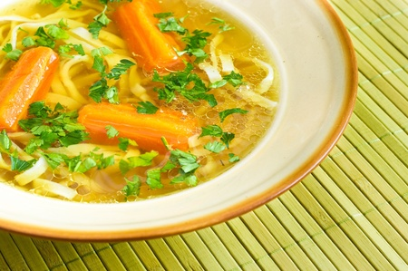 broth: Fresh broth with carrot and parsley