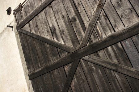 Old wooden door with big cross photo
