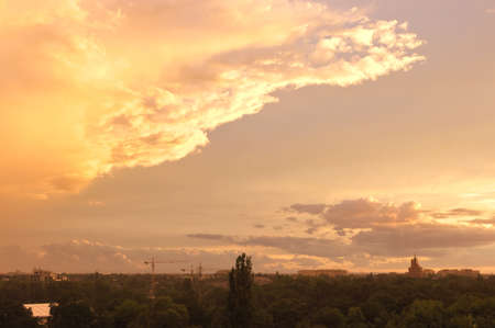 Sky over the city during the rain and sunset photo