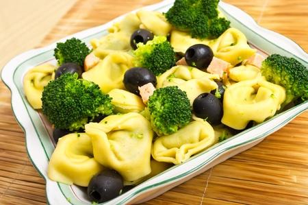 tortellini: Tortellini salad with olives, salmon and broccoli Stock Photo
