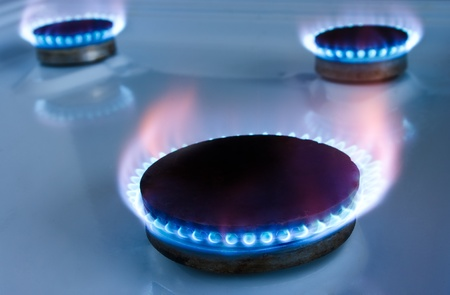 Gas burners in the kitchen oven photo