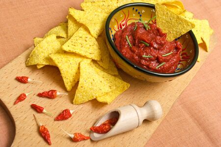 Nachos with hot tomato sauce Stock Photo - 11819428