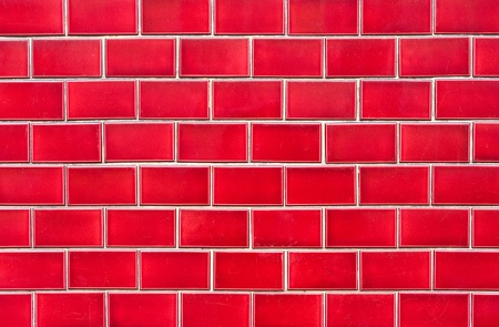 Intensive red brick wall for background photo
