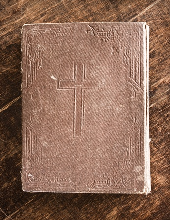 Old Bible on wooden board photo