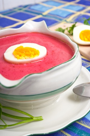 Fresh beetroot soup with egg photo