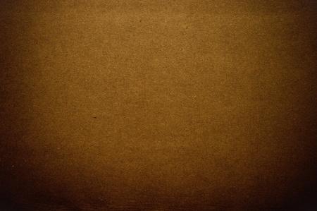 pasteboard: Grainy brown paper in dark tone