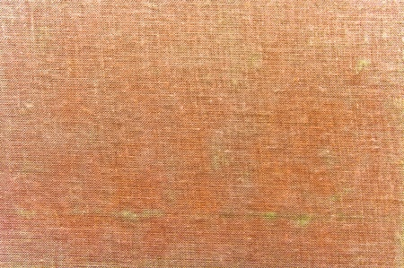 Salmon pink fabric texture for background photo