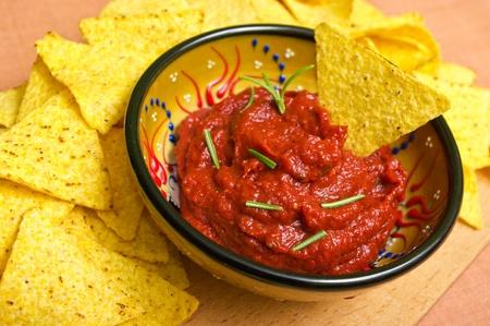 Nachos with hot tomato sauce