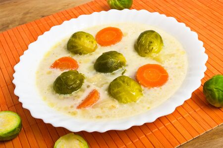 Fresh brussels sprouts soup with cream photo