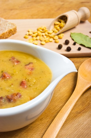 Traditional fresh pea soup in the bowl photo