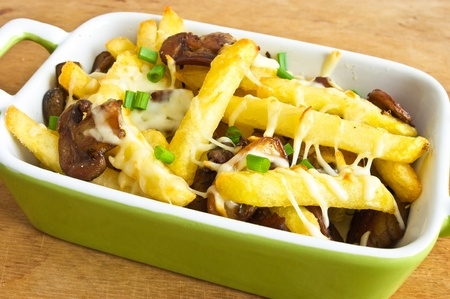 French fries casserole with champignons photo