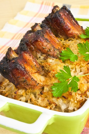 Traditional spare ribs baked in sauerkraut photo