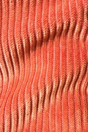 undulating: Orange undulating corduroy texture for background usage