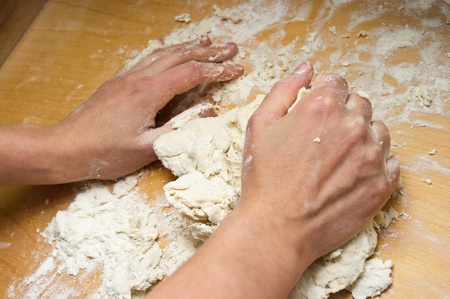 Dough making with woman hand photo