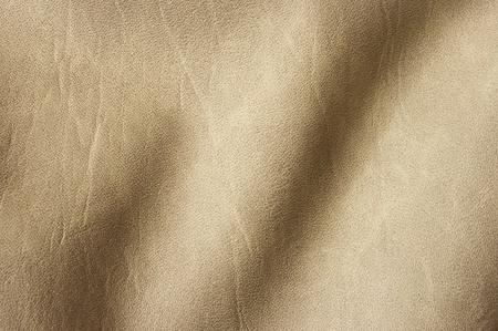 undulating: Beige undulating leather for background usage