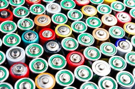 Row of different types batteries photo