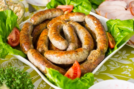 german food: Traditional baked polish sausage during the easter