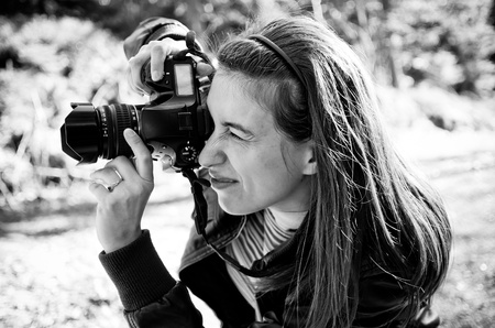 photography session: Woman photographer in BW tone Stock Photo