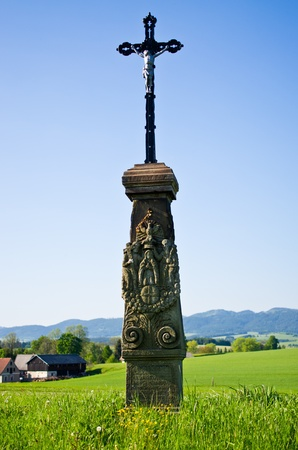 Monument with cross on the madow Stock Photo - 13884182