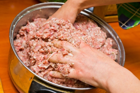Mixing minced meat by hands photo