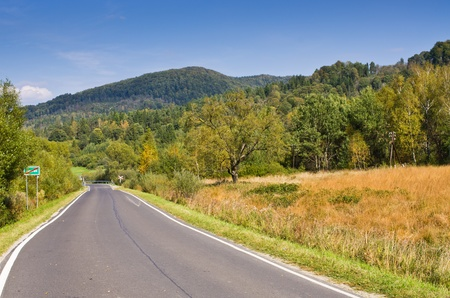 Empty road in Bieszczady mountains, Poland photo