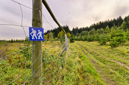 sudeten: Sign with hiking peoples on the fence
