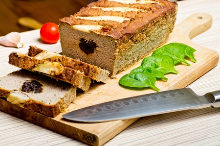 Traditional delicious pate stuffed with prunes photo