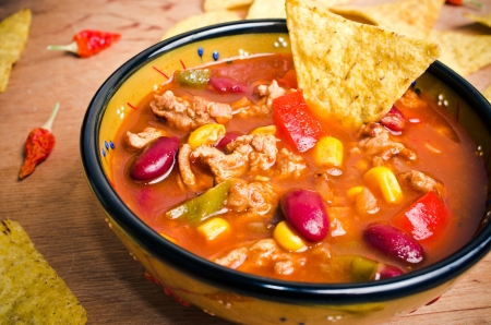 meat soup: Mexican soup (like chili con carne) with tacos Stock Photo