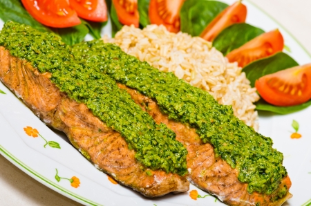Salmon with pesto and brown natural rice photo