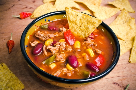 con: Mexican soup (like chili con carne) with tacos Stock Photo