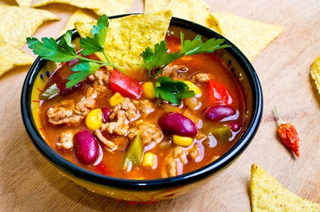 beans soup: Mexican soup (like chili con carne) with tacos Stock Photo