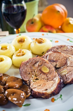 Sliced lamb roast with Silesian noodles and marinated mushrooms photo