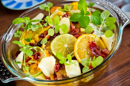 Citrus fruit salad in the glass bowl photo