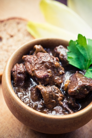 Traditional French beef bourguignon (beef stew) in the bowl