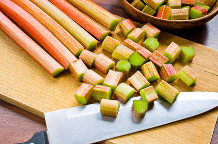 Chopped rhubarb on wooden board photo