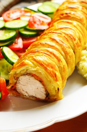 Pork fillet in puff pastry with vegetables