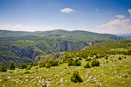 Balkans hills covered by grass and rocks photo