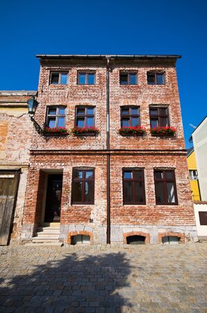 Old style brick-made tenement house Stock Photo