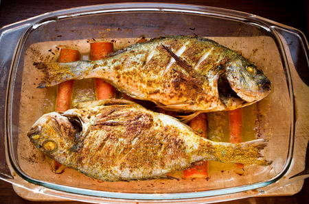 dorade: Dorade baked with curry on the carrots in oriental style Stock Photo